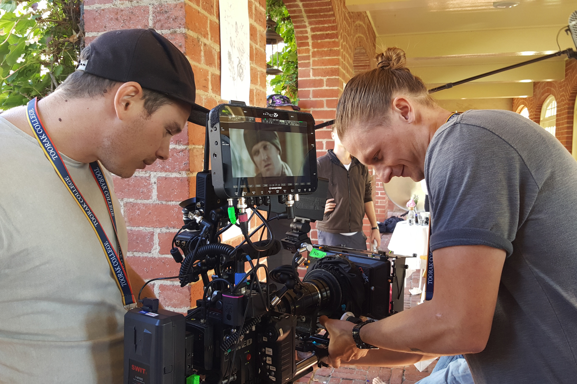 Cinematographer Shaun Herbertson with 1st Camera Assist, Marcus Cropp, set up the next shot